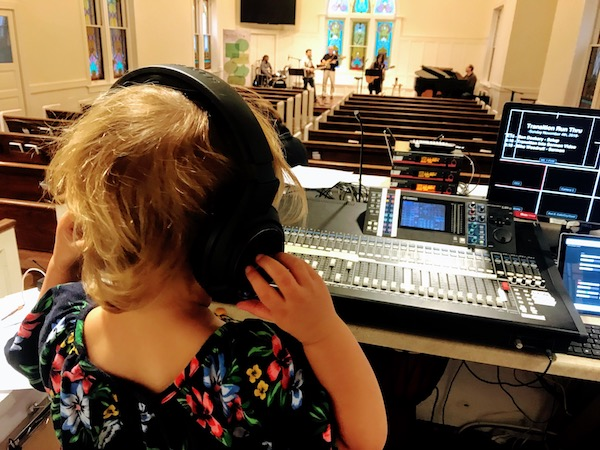 Clara at the sound board